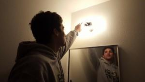 Chris installing CFL bulbs